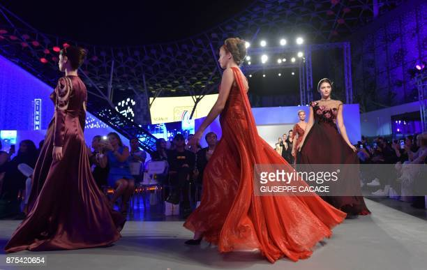 Models present on the catwalk creations of Renato Balestra during the Arab Fashion Week in the United Arab Emirate of Dubai on November 17 2017 / AFP...