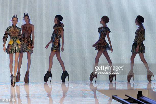 Models present outfits by British deigner Alexander McQueen during readytowear SpringSummer 2010 fashion show on October 6 2009 in Paris AFP PHOTO...