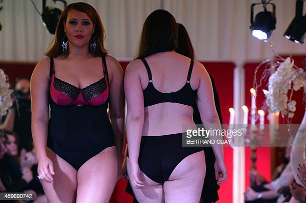 Models present plussize lingerie during the Pulp fashion show in Paris on November 28 2014 AFP PHOTO / BERTRAND GUAY
