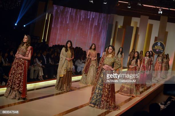 Models present the creation by designer Uzma Babar on the second day of Fashion Bridal Couture Week in Karachi on April 1 2017 / AFP PHOTO / RIZWAN...