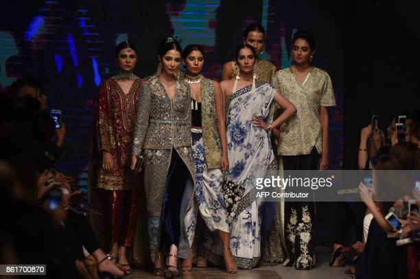 Models present the creation of designer Mahgul during the second day of the Pakistan Fashion Design Council LOreal Paris Bridal Week in Lahore on...
