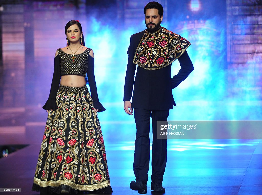 Models present the creations by designer Yasmin Zaman on the first day of Bridal Couture Week- Gold Edition in Karachi on May 6, 2016. / AFP / ASIF