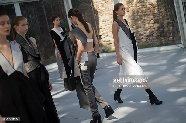 Models present to the jury creations of Swedish Amanda Svart during the 31st edition of the International Festival of Fashion and Photography at the...