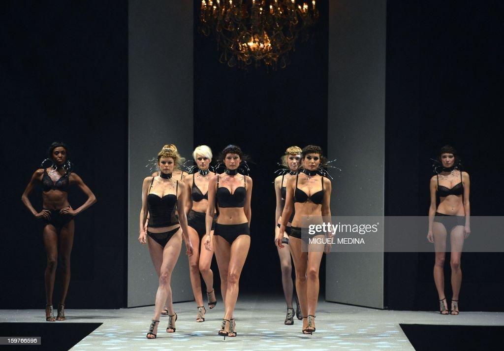 Models present underwear garments during the Salon de la lingerie ( International Lingerie Fair) on January 20, 2013 in Paris. AFP PHOTO MIGUEL MEDINA