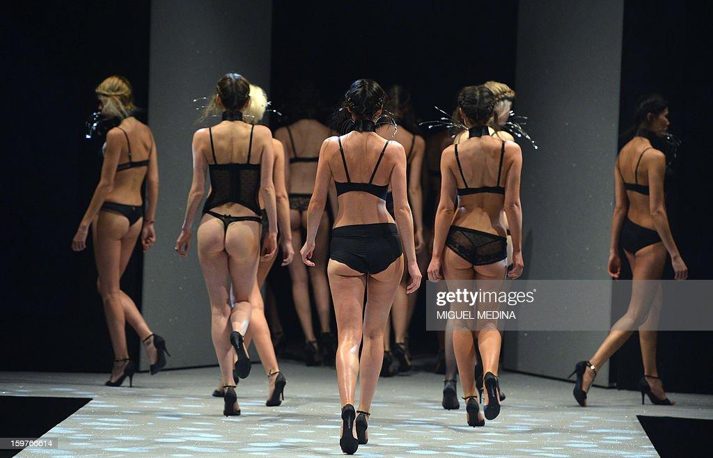 Models present underwear garments during the Salon de la lingerie (International Lingerie Fair) on January 20, 2013 in Paris.