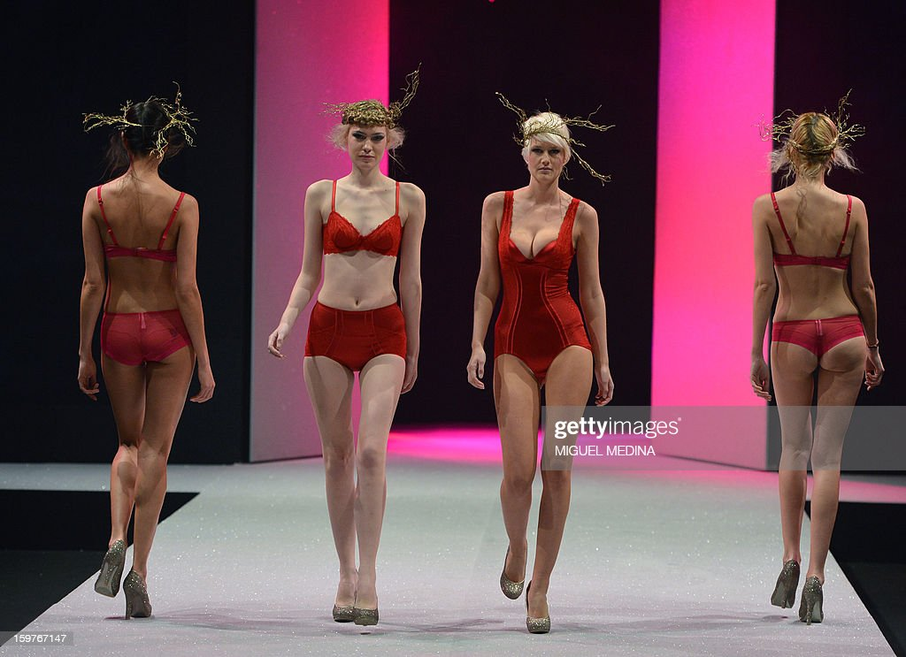 Models present underwear garments during the Salon de la lingerie (International Lingerie Fair) on January 20, 2013 in Paris.