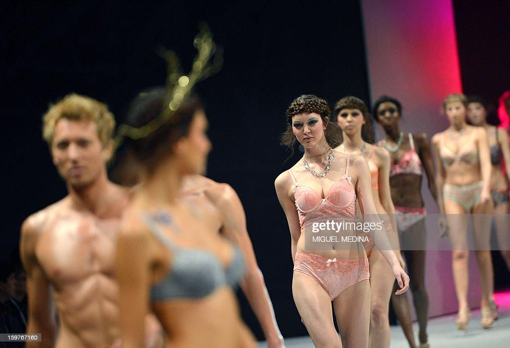 Models present underwear garments during the Salon de la lingerie (International Lingerie Fair) on January 20, 2013 in Paris. AFP PHOTO MIGUEL MEDINA