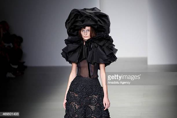 Models presenting a creation from the John Rocha collection during the 2014 Autumn / Winter London Fashion Week in London on February 15 2014