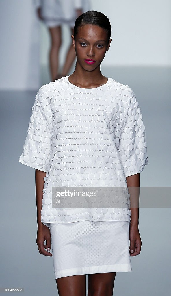 A models presents a creation by J JS Lee during the 2014 Spring/Summer London Fashion Week in London on September 13, 2013.