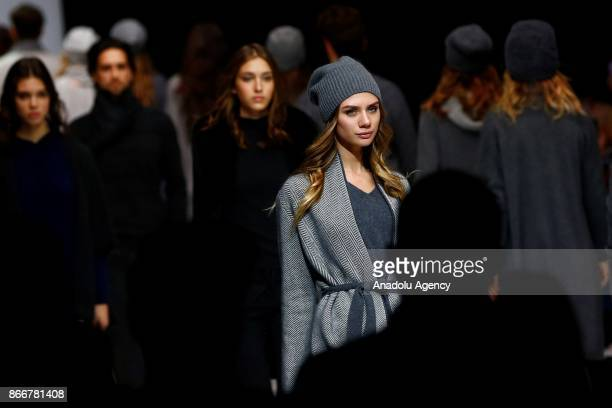 Models presents a creation by Mir Cashemira during the Moscow Fashion Week in Moscow Russia on October 26 2017