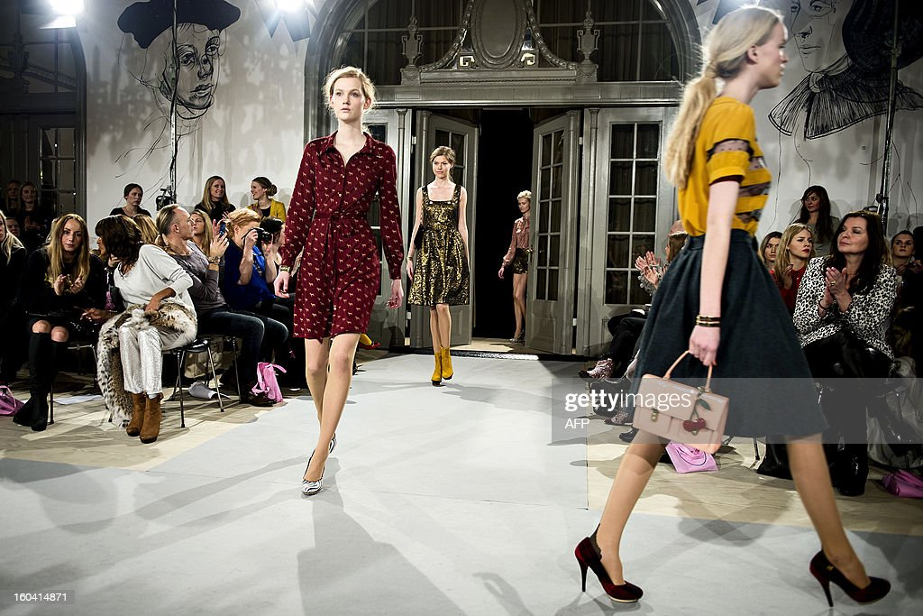 Models presents a creation of Danish fashion house Edith & Ella Spring/Summer 2013 collection at the Hotel Nimb during the Copenhagen Fashion Week 2013, in Copenhagen, Denmark, on January 30, 2013. AFP PHOTO / SCANPIX/TORKIL ADSERSEN DENMARK OUT