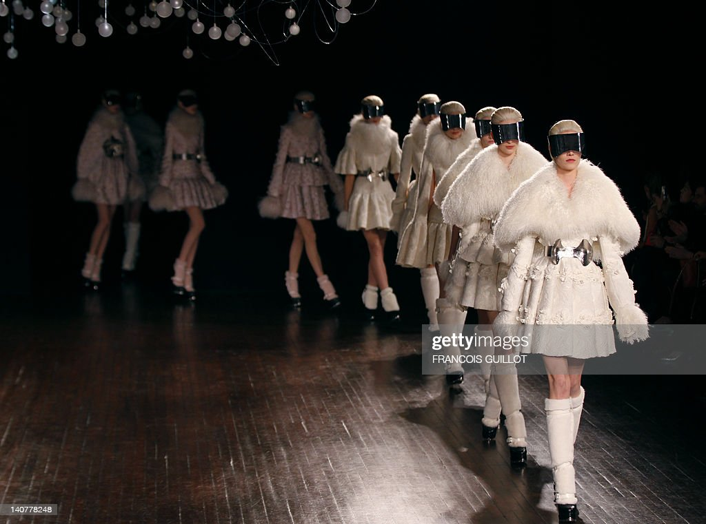 Models presents creations by British fashion designer Sarah Burton for Alexander McQueen during the Fall/Winter 2012-2013 ready-to-wear collection show, on March 6, 2012 in Paris. AFP PHOTO/FRANCOIS GUILLOT