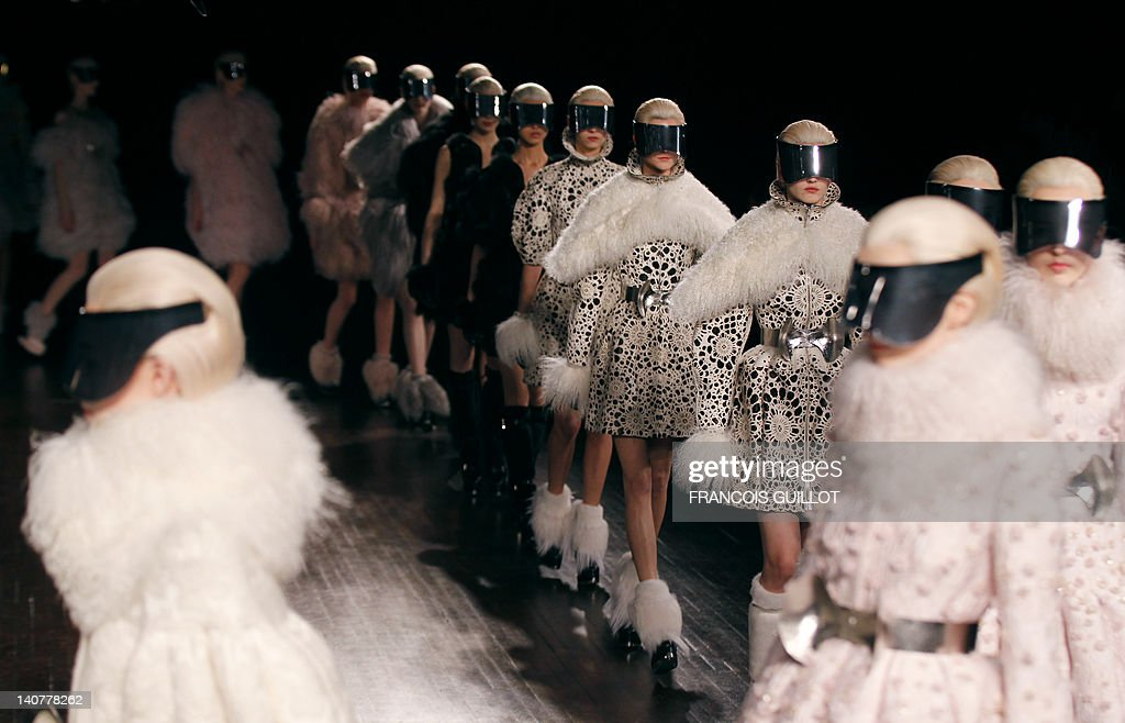 Models presents creations by British fashion designer Sarah Burton for Alexander McQueen during the Fall/Winter 2012-2013 ready-to-wear collection show, on March 6, 2012 in Paris.