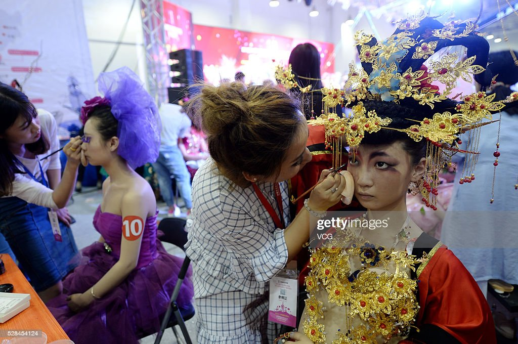 Models receive makeup during the 31th China (Jinan) International Beauty, Hairdressing & Cosmetics Expo on May 5, 2016 in Jinan, Shandong Province of China. Participants showed various makeups and attire on the exposition.