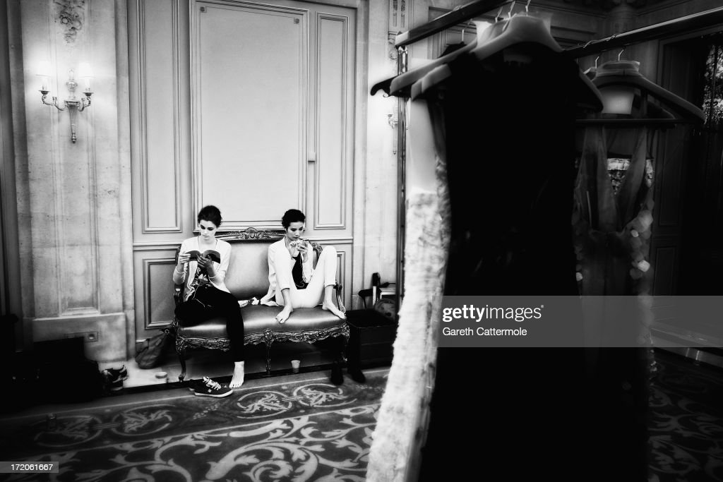 Models relax backstage before the Rami Al Ali show as part of Paris Fashion Week Haute-Couture Fall/Winter 2013-2014 on July 1, 2013 at the Le Meurice Salon Pompadour in Paris, France.