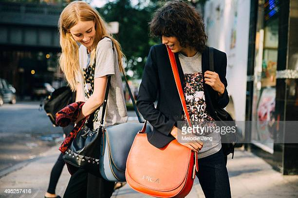 Models Rianne van Rompaey and Mica Arganaraz exit the Coach show on September 15 2015 in New York City Both girls wear a floral Coach SS16 fashion...
