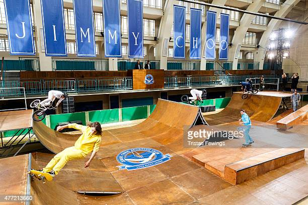 Models ride skateboards during the Jimmy Choo presentation during The London Collections Men SS16 at Seymor Leisure Centre on June 15 2015 in London...