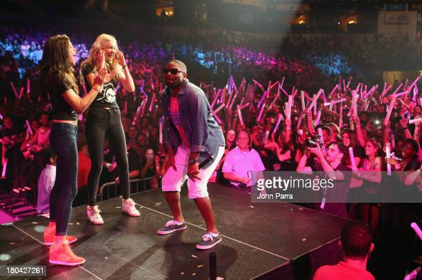 Models Sara Sampaio and Elsa Hosk dance with DJ Irie onstage at the Victoria's Secret PINK Nation Campus Party at University of Central Florida on...