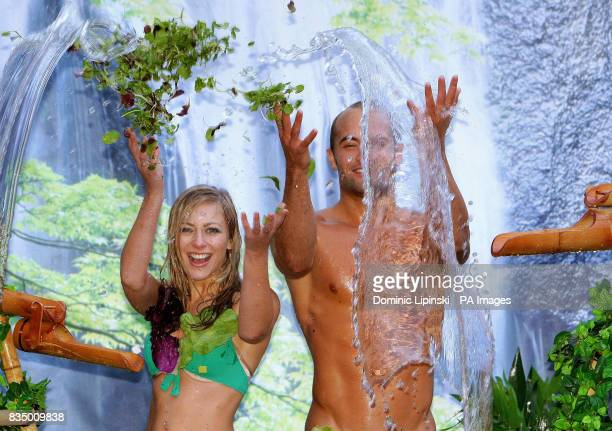 Models SarahLouise Green and David White are showered in spring water and salad leaves at a photocall to promote 'Washed Only in Spring Water' bagged...
