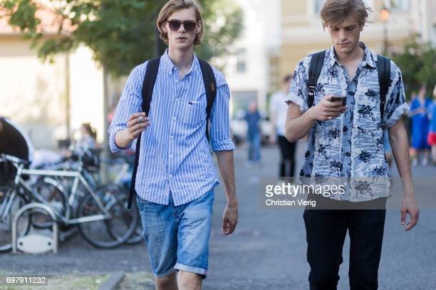 Models seen outside Malibu 1992 during Milan Men's Fashion Week Spring/Summer 2018 on June 19 2017 in Milan Italy