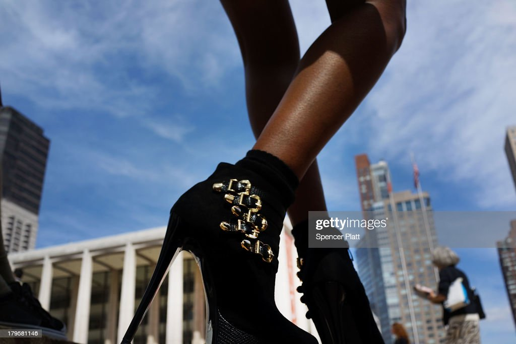 A model's shoes are viewed as she relaxes in Lincoln Center on the first day of New York Fashion Week on September 5 2013 at in New York City One of...