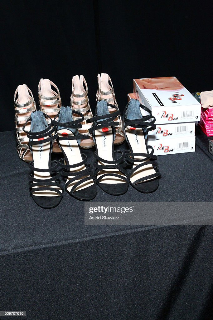 Models shoes on display backstage at the Tadashi Shoji Fall 2016 fashion show during New York Fashion Week: The Shows at The Arc, Skylight at Moynihan Station on February 12, 2016 in New York City.