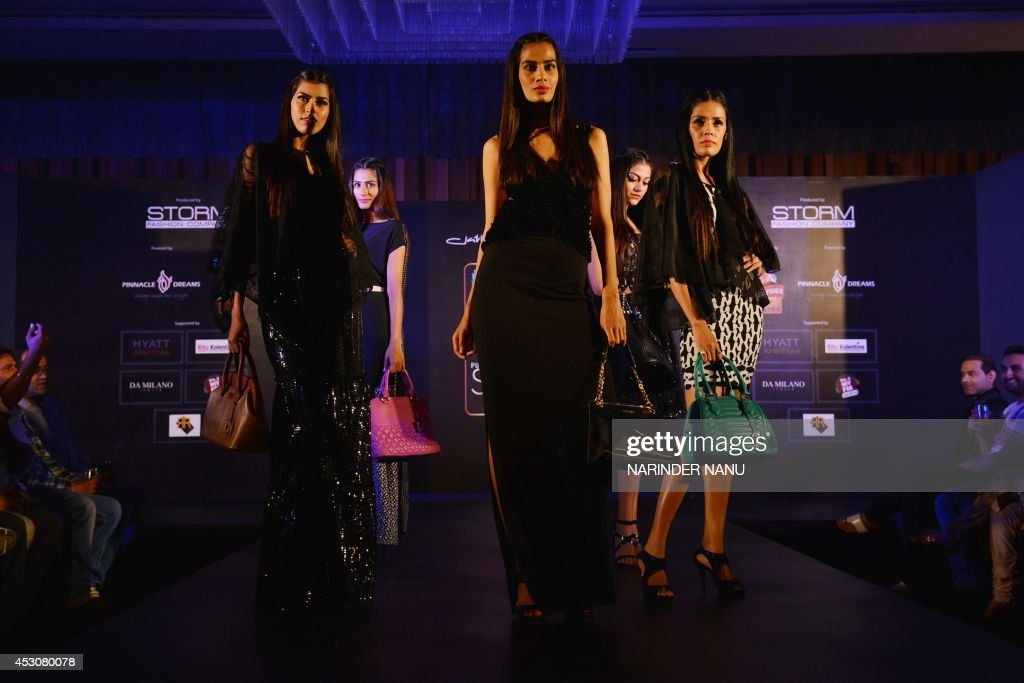 Models show creations by Indian designer Jattinn Kochhar and Sheetal Lyall during the fashion show Kingfisher Ultra Punjab Style Tour in Amritsar on August 2, 2014 .