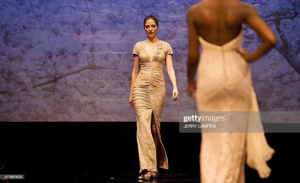 Models show creations of Dutch fashiondesigner Addy van den Krommenacker during the presentation of his Viago a Venezia collection 2014 in Amsterdam...