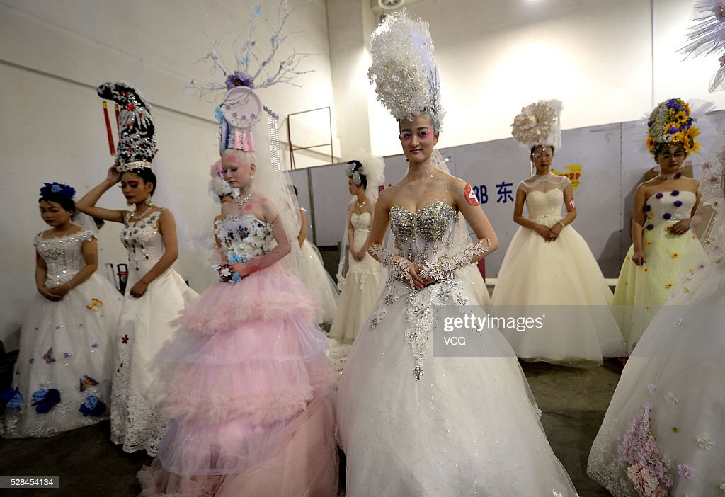 Models show makeups and attire during the 31th China (Jinan) International Beauty, Hairdressing & Cosmetics Expo on May 5, 2016 in Jinan, Shandong Province of China. Participants showed various makeups and attire on the exposition.