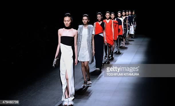 Models show off creations by Indonesian fashion brand Major Minor's three designers Ari Septutra Ambar Pratwi and Inneke Margarethe during Tokyo...