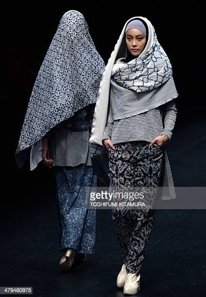 Models show off creations by Indonesian fashion designer Windri Widiesta Dhari for her brand's Nur Zahra 20142015 autumn/winter collection at the...