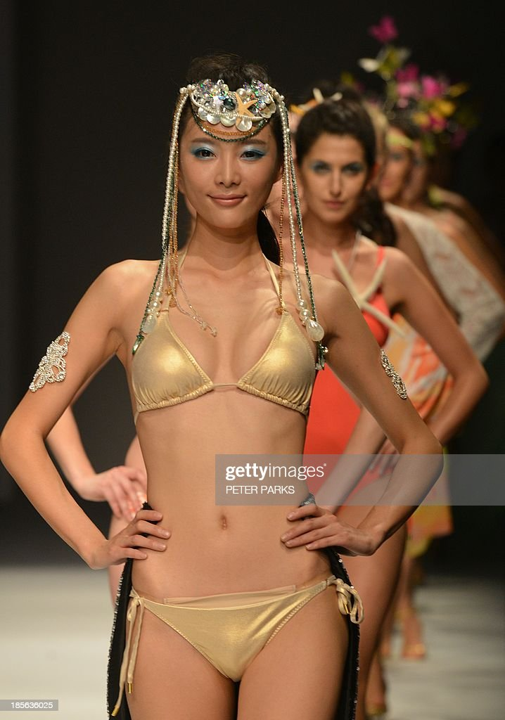 Models show off creations by Maryan Mehlhorn during the Shanghai Mode Lingerie Fashion show in Shanghai on October 23, 2013. The show is a part of Shanghai's bi-annual Fashion Week. AFP PHOTO/Peter PARKS