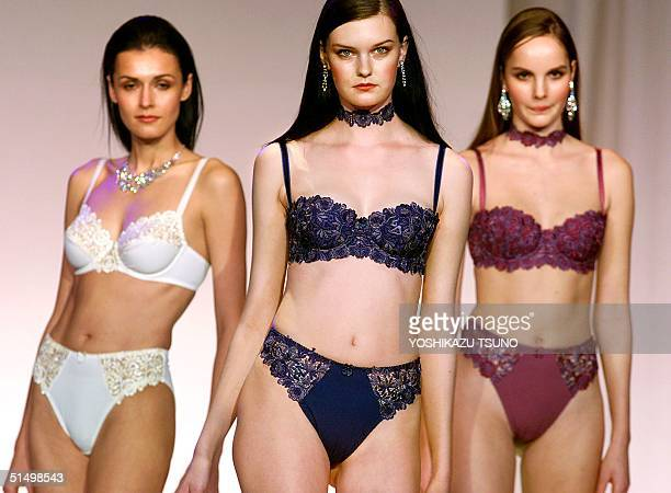 Models show off French lingerie maker Wolf's latest collection 'Byzance' during a French lingerie fashion show in Tokyo 30 November 2000 night Six...
