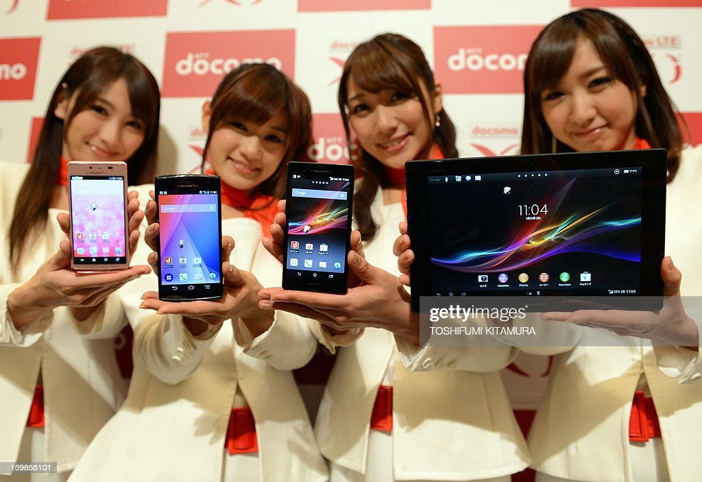 Models show off NTT Docomo's new smartphones (from L; Aquos Phone EX, Arrows X and Xperia Z) and Xperia Tablet Z (R) during the company's 2013 Spring lineup press preview in Tokyo on January 22, 2013. The new lineup of 11 smartphones and tablets plus one mobile Wi-Fi router will launch in sequence beginning on January 25 in Japan.