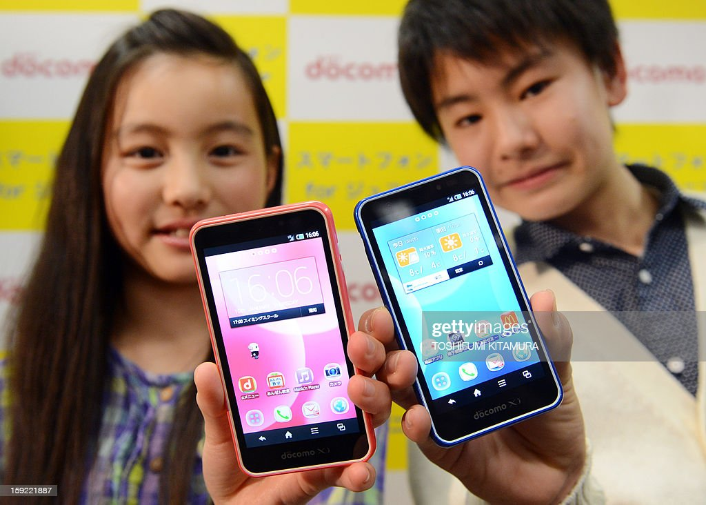 Models show off NTT DOCOMO's 'SH-05E,' the latest smartphones for Juniors during its press preview in Tokyo on January 10, 2013. The water-resistant and dustproof smartphone enables parents to control voice calls and usage by setting restrictions on time of day, maximum amount of call time, as well as email and online activity.