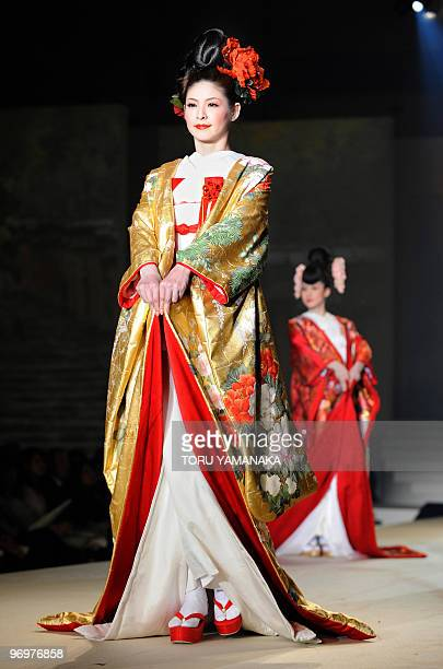 Models show off wedding kimonos by Japanese bridal designer Yumi Katsura during her 2010 grand collection presentation in Tokyo on February 23 2010...
