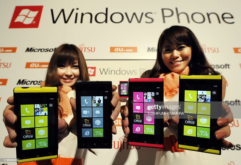 Models show off 'Windows Phone IS12T' smartphones during its press preview in Tokyo on July 27, 2011. Japan's telecom company KDDI will put the Fujitsu Toshiba Mobile Communications-made phones with Microsoft's Windows Phone 7.5 operatiing system onto the Japanese market from September this year.