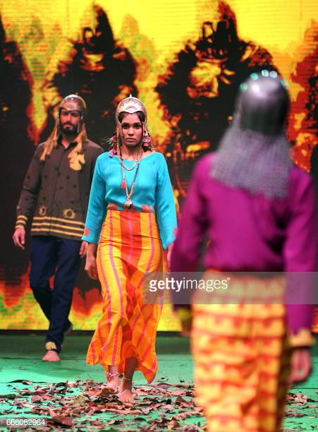 Models showcase a collection inspired by the upcoming Hindi film 'Baahubali 2' in Mumbai on April 7 2017 / AFP PHOTO /