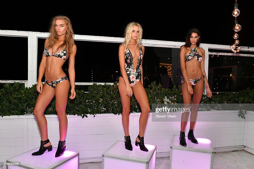 Models showcase Beach Riot swimwear at Dash X Beach Riot Miami at Soho Beach House on July 15, 2016 in Miami Beach, Florida.