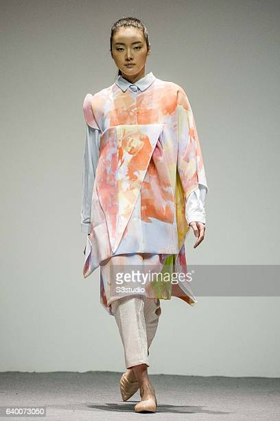 Models showcase Catherine Hudson designs on the runway during the The EcoChic Design Award 2013 by Redress as part of the Hong Kong Fall/Winter...