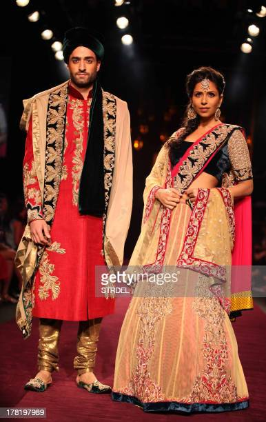 Models showcase creations by designers Shyaml and Bhumika during the Lakme Fashion Week Winter/Festival 2013 in Mumbai on August 27 2013 AFP PHOTO/...