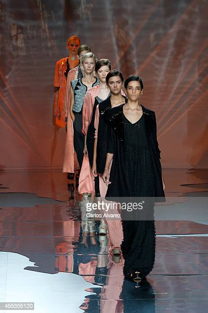 Models showcase designs by Ailanto on the runway at Ailanto show during Mercedes Benz Fashion Week Madrid Spring/Summer 2015 at Ifema on September 13...