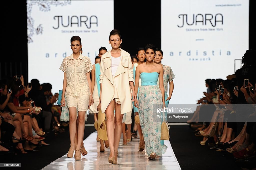 Models showcase designs by Ardistia New York on the runway during Jakarta Fashion Week 2014 at Senayan City on October 21, 2013 in Jakarta, Indonesia.