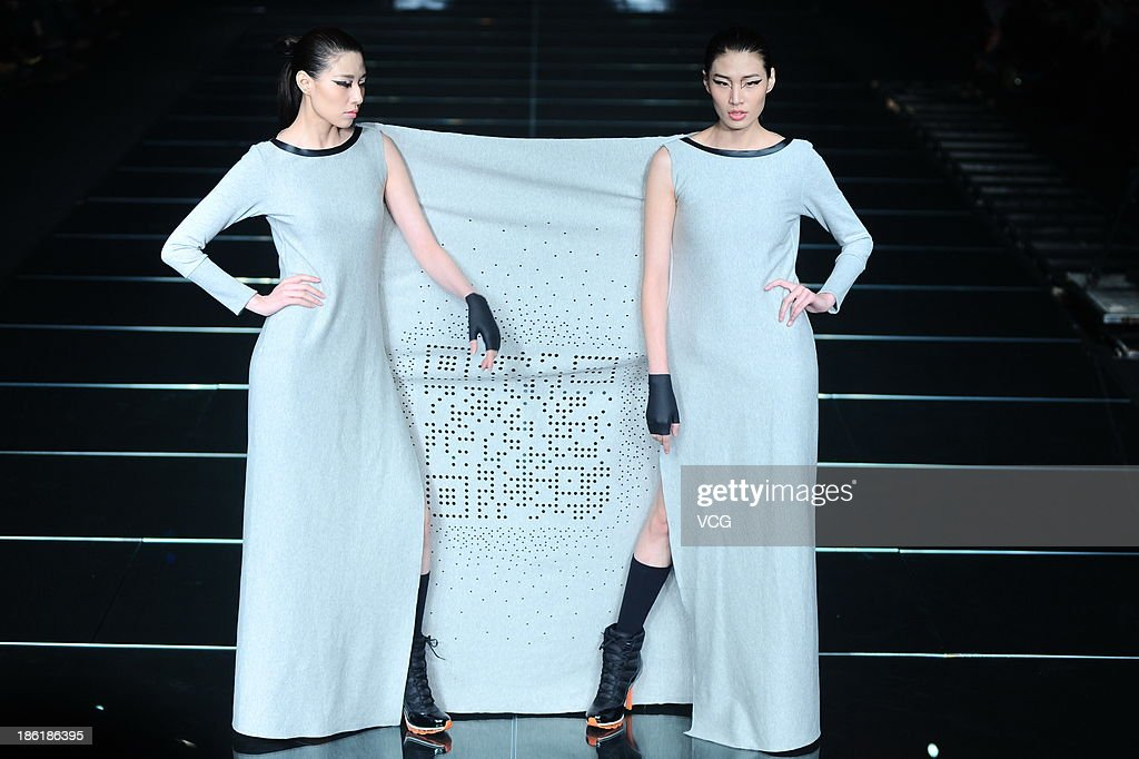 Models showcase designs by Chen Jianping on the runway at the QIAODAN Chen Jianping Sports Wear Collection show during Mercedes-Benz China Fashion Week Spring/Summer 2014 at 751 D.PARK Workshop on October 28, 2013 in Beijing, China.
