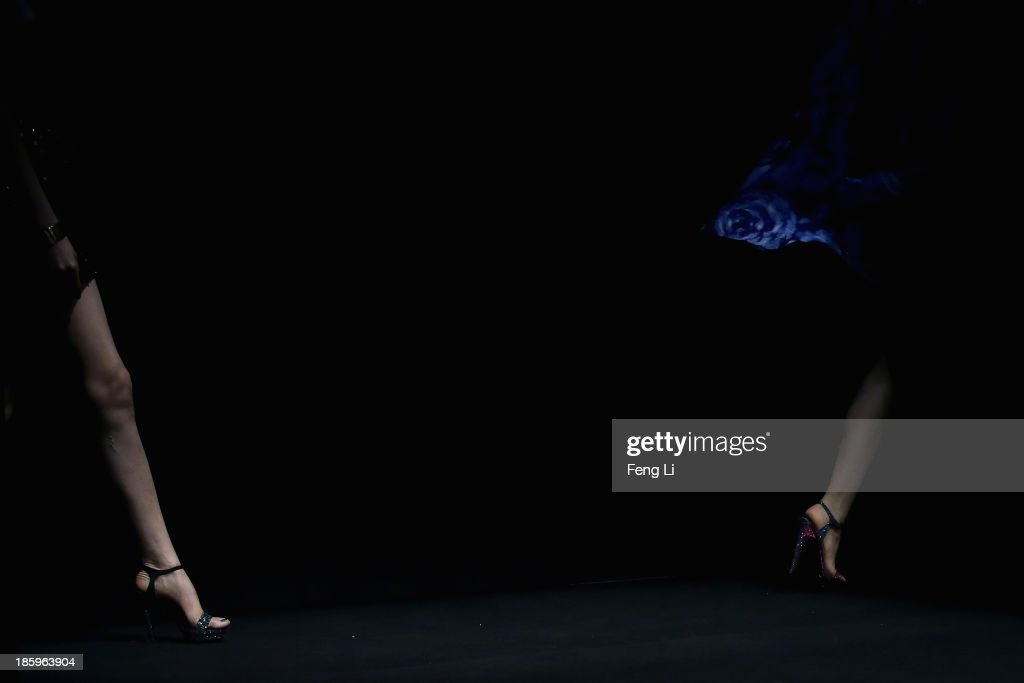 Models showcase designs by Chinese designer Lin Ruoping on the runway at STELLA LAM Lin Ruoping Dress Collection show during Mercedes-Benz China Fashion Week Spring/Summer 2014 at 751 D-PARK Workshop on October 26, 2013 in Beijing, China.