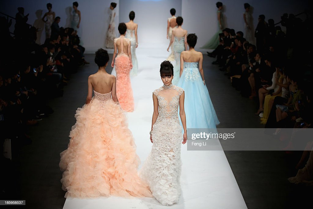Models showcase designs by Chinese designer Zhang Jingjing on the runway at Zhang Jingjing Haute Couture Collection show during Mercedes-Benz China Fashion Week Spring/Summer 2014 at 751 D-PARK Central Halll on October 26, 2013 in Beijing, China.