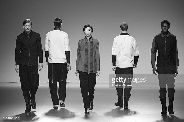 Models showcase designs by Etxeberria on the runway at Etxeberria show during Mercedes Benz Fashion Week Madrid Fall/Winter 2014 at Ifema on February...