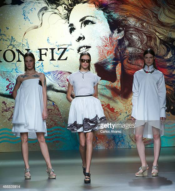 Models showcase designs by Ion Fiz on the runway at Ion Fiz show during Mercedes Benz Fashion Week Madrid Spring/Summer 2015 at Ifema on September 12...