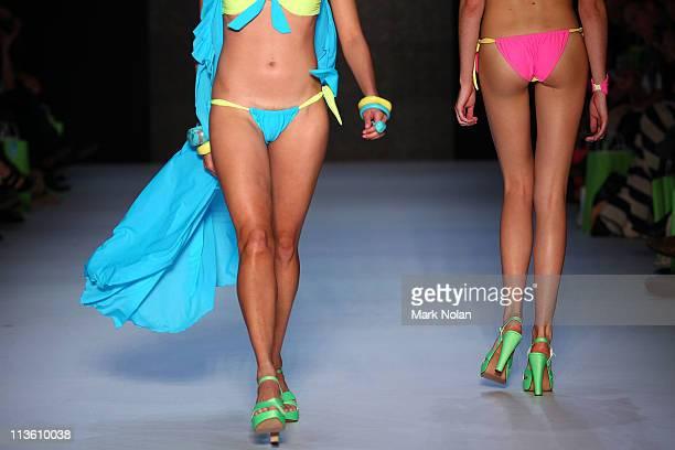Models showcase designs by Karen Neilsen Collection in the Swim Resort Wear on the catwalk during Rosemount Australian Fashion Week Spring/Summer...