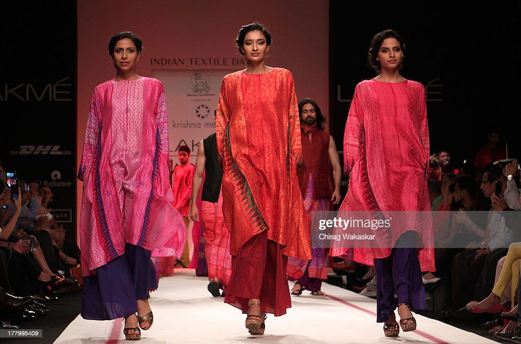 Models showcase designs by Krishna Mehta during day 4 of Lakme Fashion Week Winter/Festive 2013 at the Hotel Grand Hyatt on August 26, 2013 in Mumbai, India.